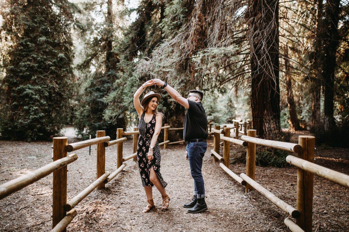man and woman dancing between brown wooden handrails