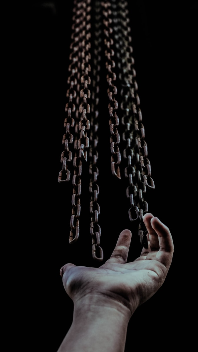 man's hand and chains